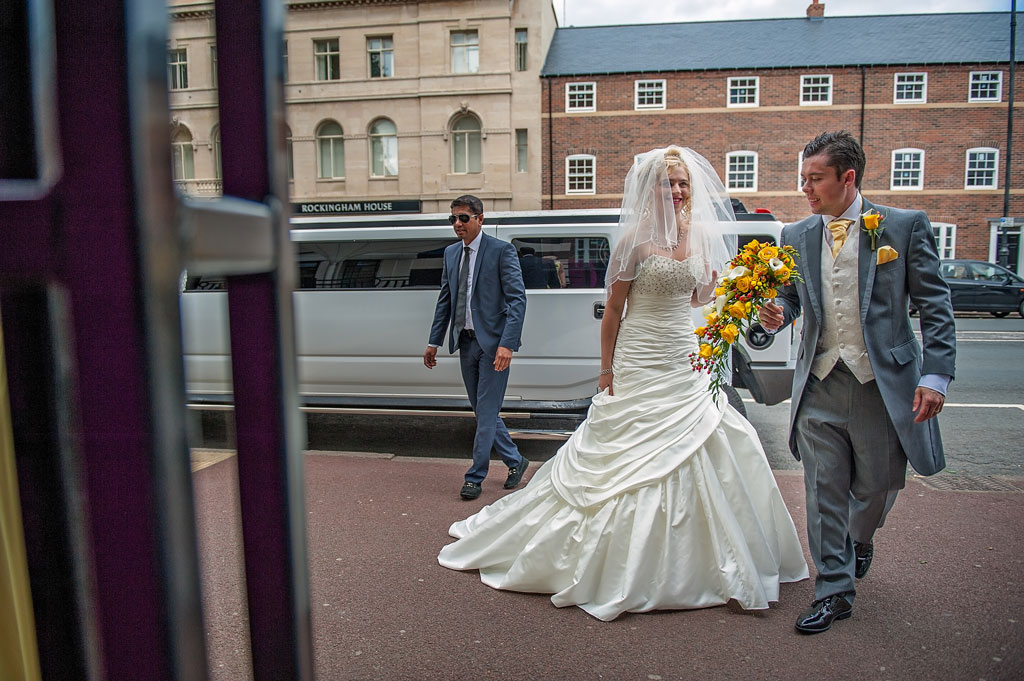 Wedding limo with bride and groom outside The Earl of Doncaster Hotel