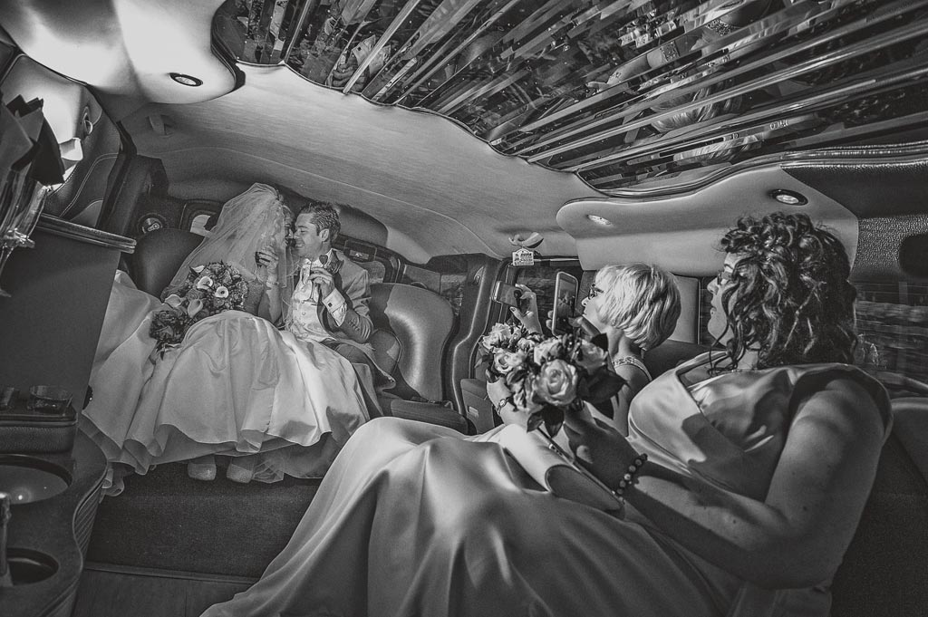 Bride and groom in a wedding limo