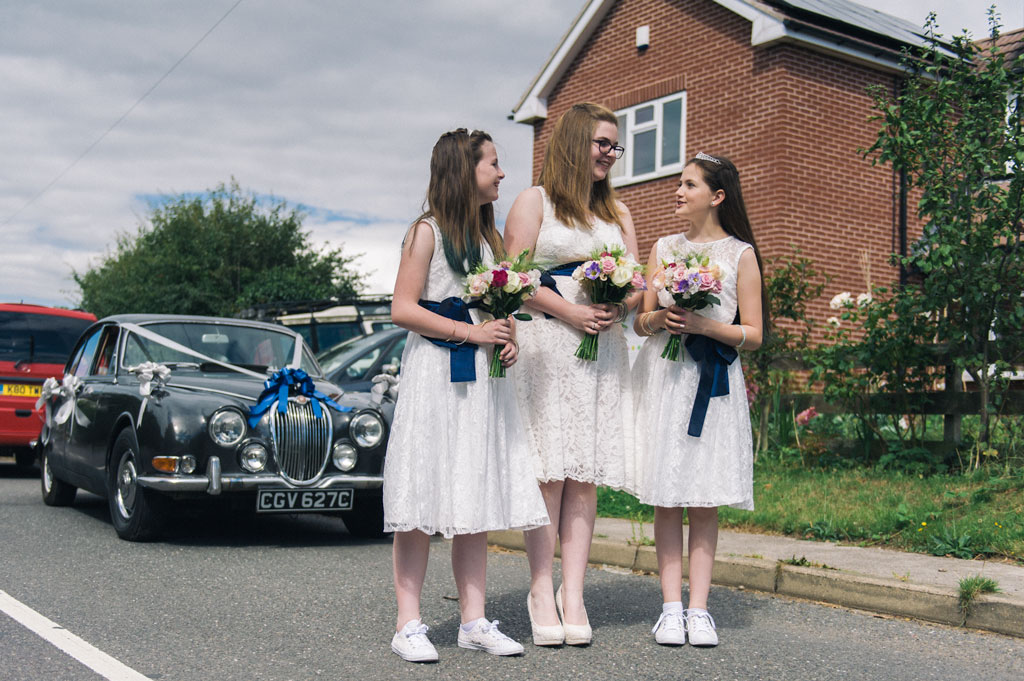 Bridesmaids waiting outside brodes house in Misson Nottinghamshire