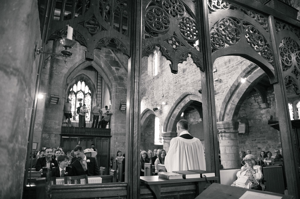 Groom waiting for the bride at St John the Baptist's church in Misson in Nottinghamshire