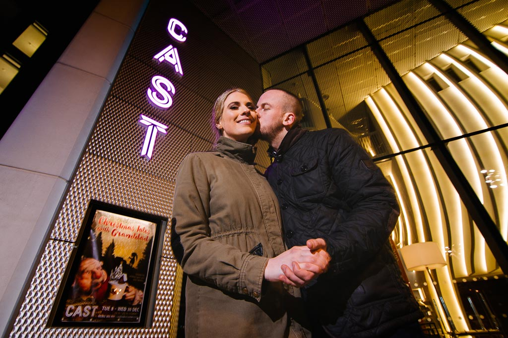 Newly engaged couple kissing outside Cast theatre in Doncaster, South Yorkshire