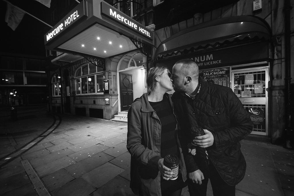 Nighttime pre wedding portrait of an engaged couple outside Mercure Hotel in Yorkshire
