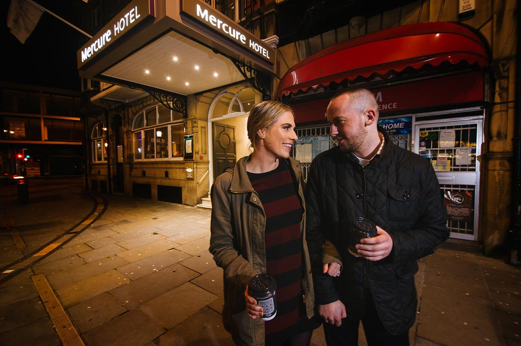 Nighttime portrait of an engaged couple outside Danum Hotel in Doncaster