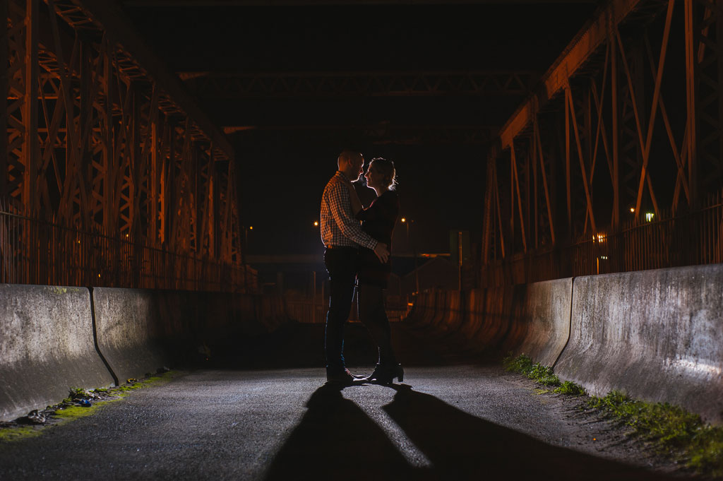 Engaged couple backlit at night in Doncaster