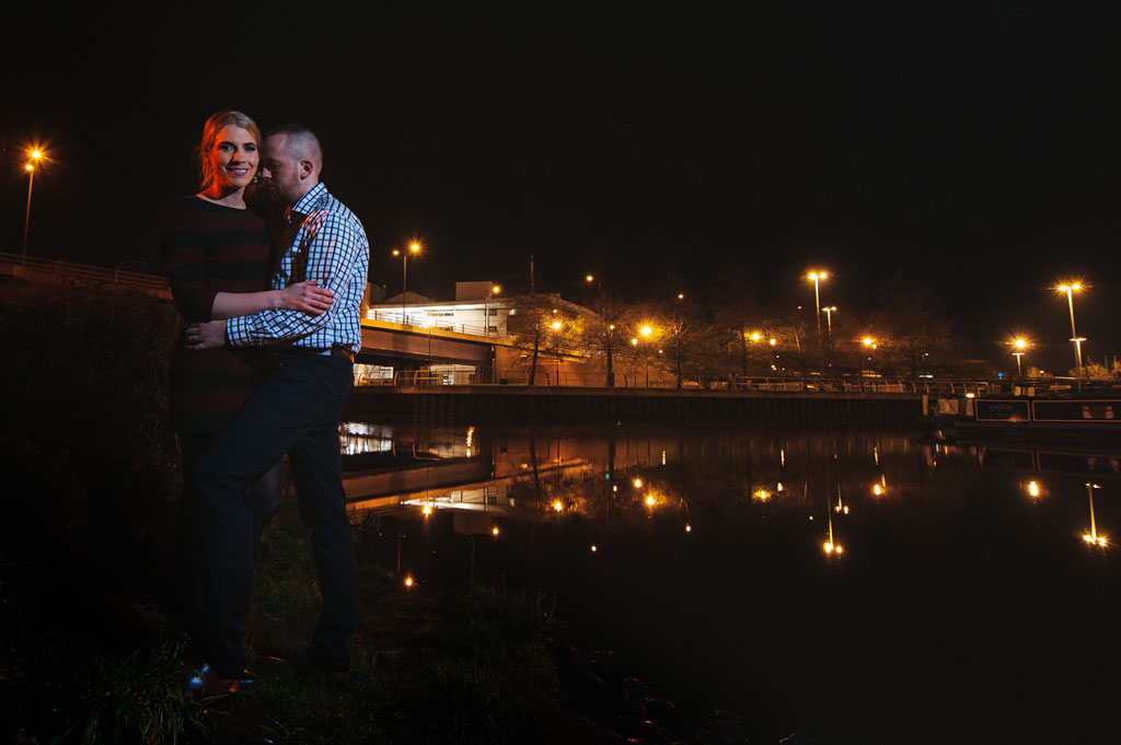 Nighttime portrait of an engaged couple overlooking Doncaster College