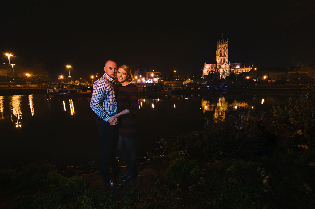 Nighttime portrait of an engaged couple overlooking Doncaster Minster