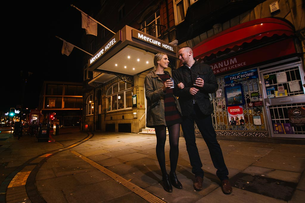 Nighttime pre wedding portrait of an engaged couple outside Mercure Hotel in Doncaster