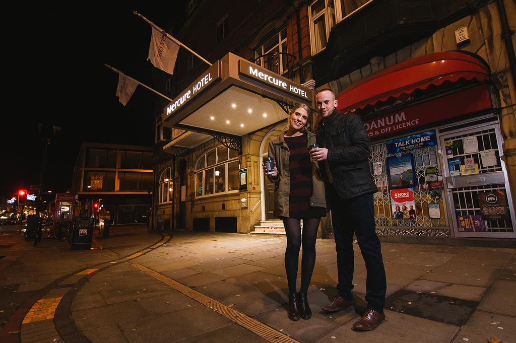 Nighttime portrait of an engaged couple outside Mercure Hotel in Doncaster