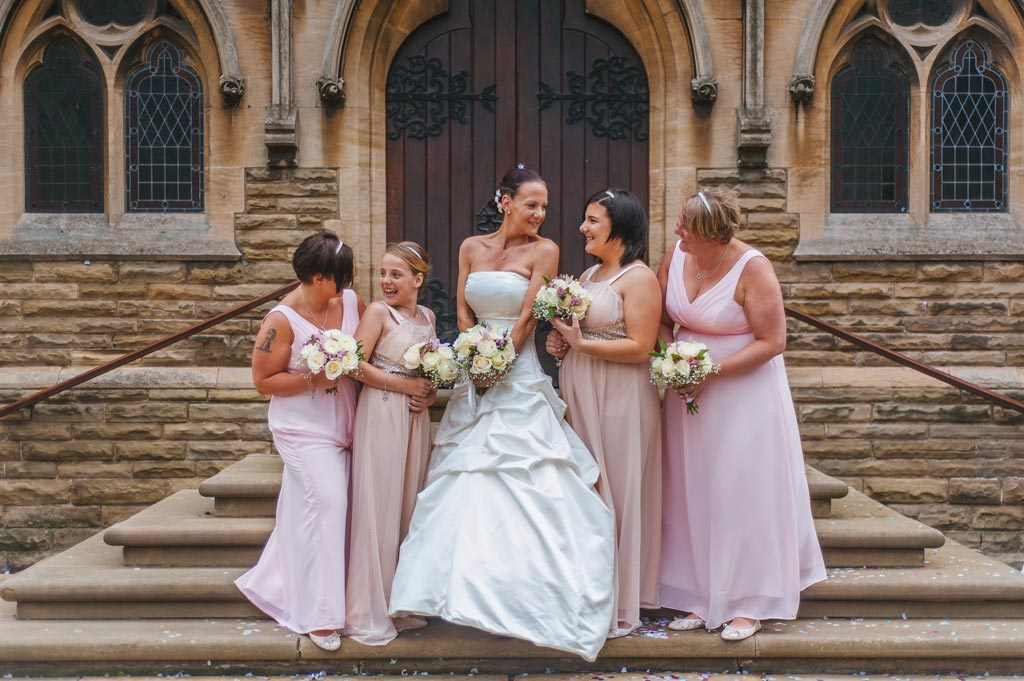 Bride and bridesmaids outside church in Epworth