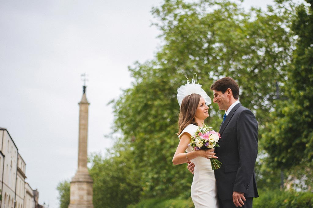 Wedding portraits with a weather vain tower in South Yorkshire