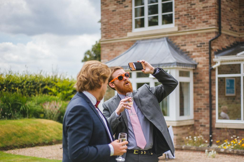 Wedding guests taking a selfie at The Parsonage Hotel York