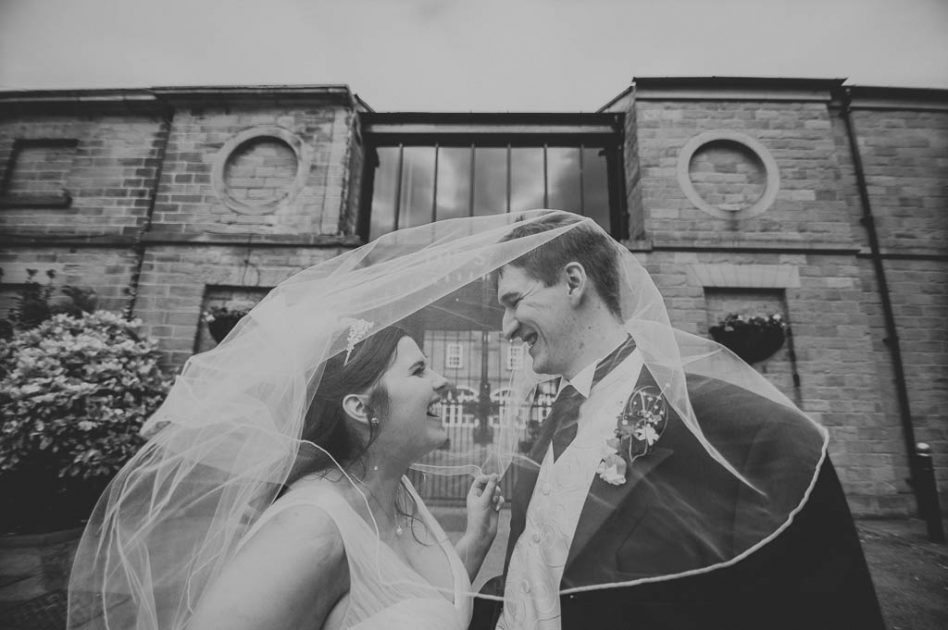 Bride and Groom outside The Stables