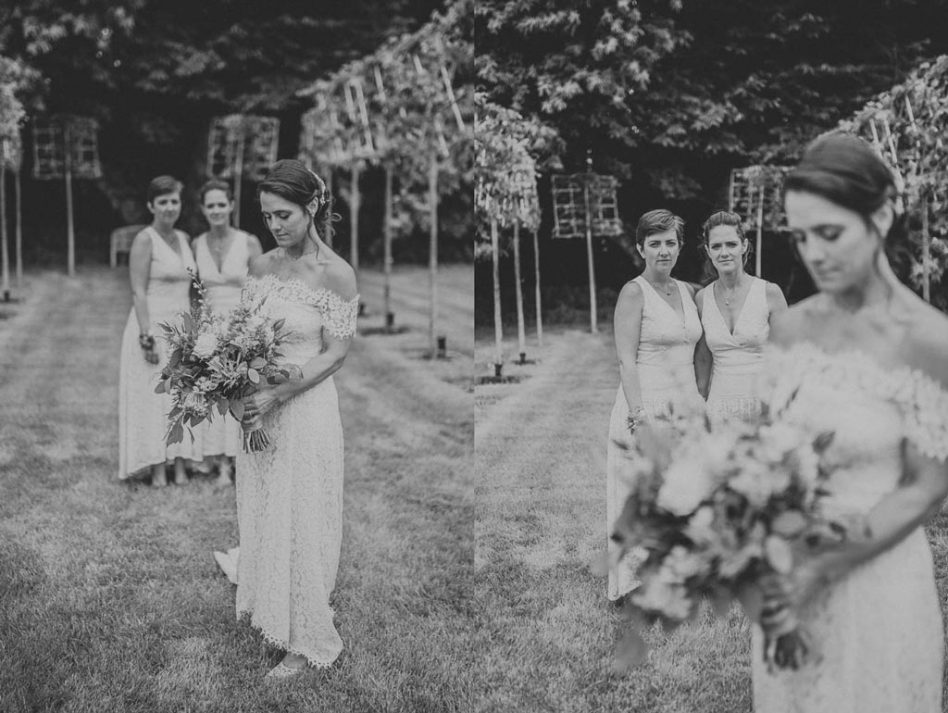 Bride with bridesmaids outside Hazel Gap Barn in Nottinghamshire