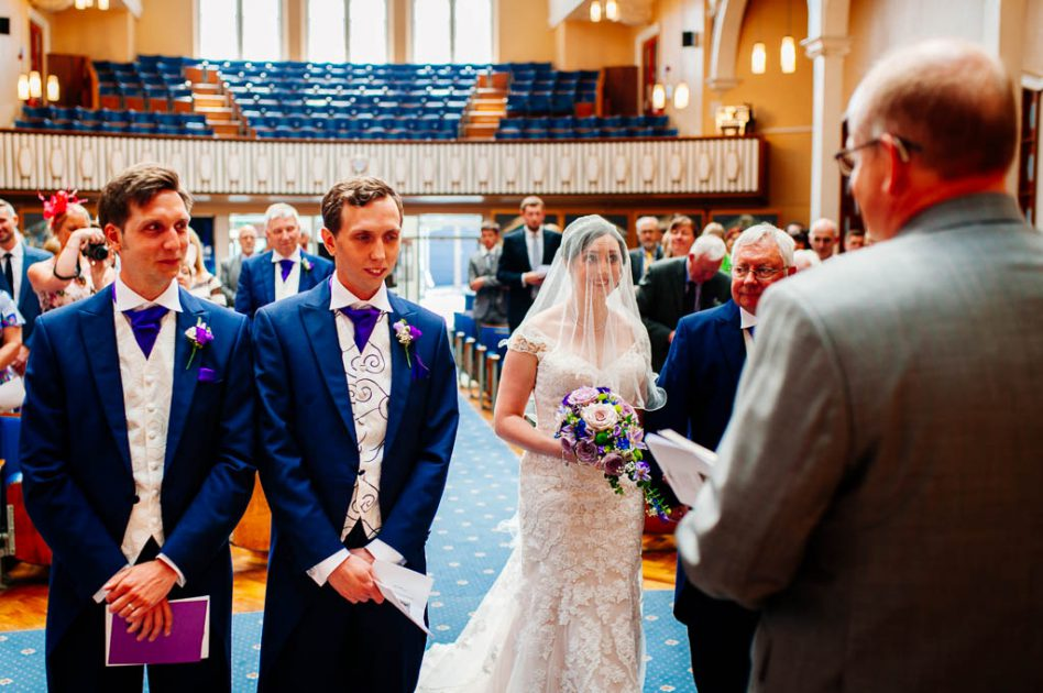 Bride walking down aisle at Victoria Hall Methodist Church in SHeffield