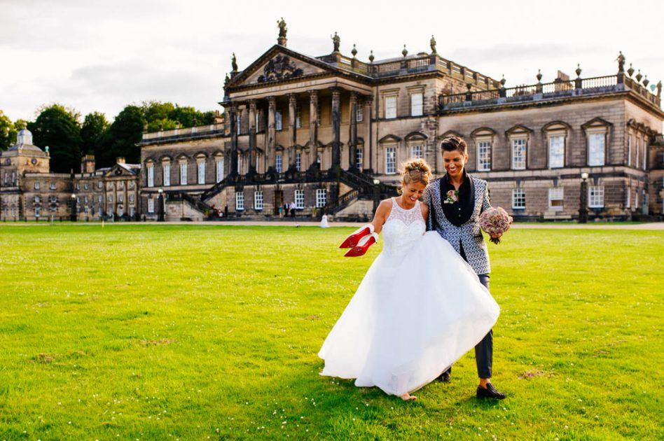 Two brides walking outside Wentworth Woodhouse in Rotherham