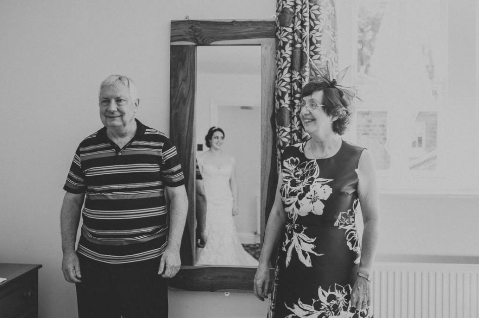 Mother and father seeing bride for the first time