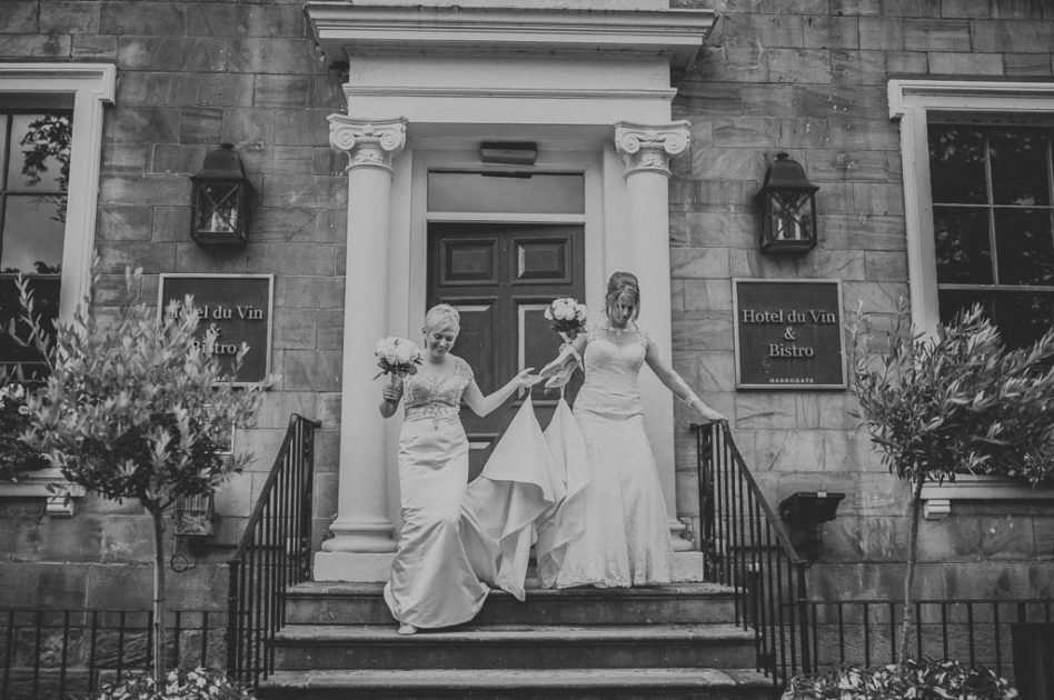 Bride and bride outside Hotel du Vin in Harrogate