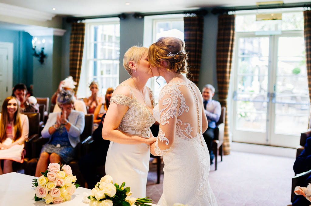 Brides kissing during a same sex wedding ceremony at hotel duVin in Harrogate
