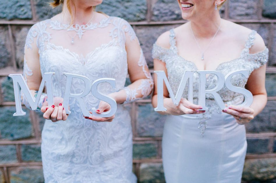 Brides holding Mrs & Mrs letters