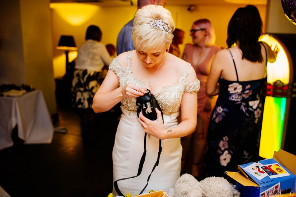 Bride with an Instax camera