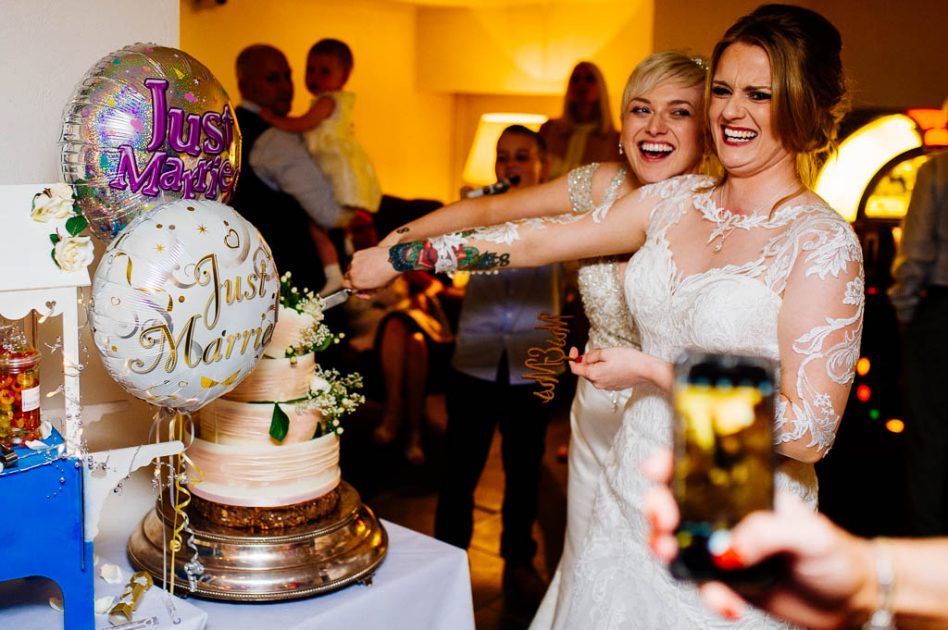 Newly married brides cutting cake at Hotel du Vin Harrogate wedding
