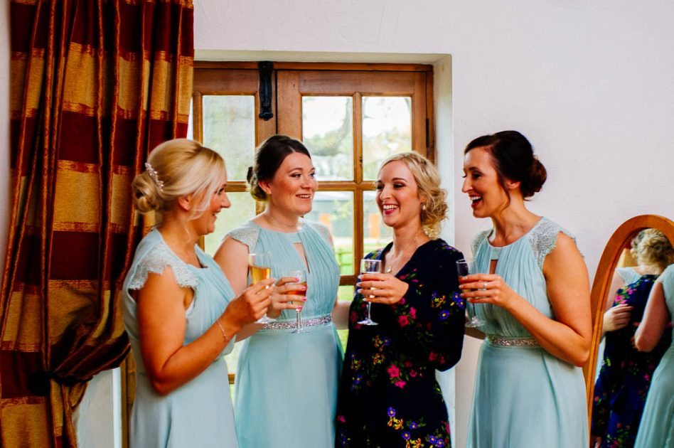 Bride and bridesmaids with a glass of champagne