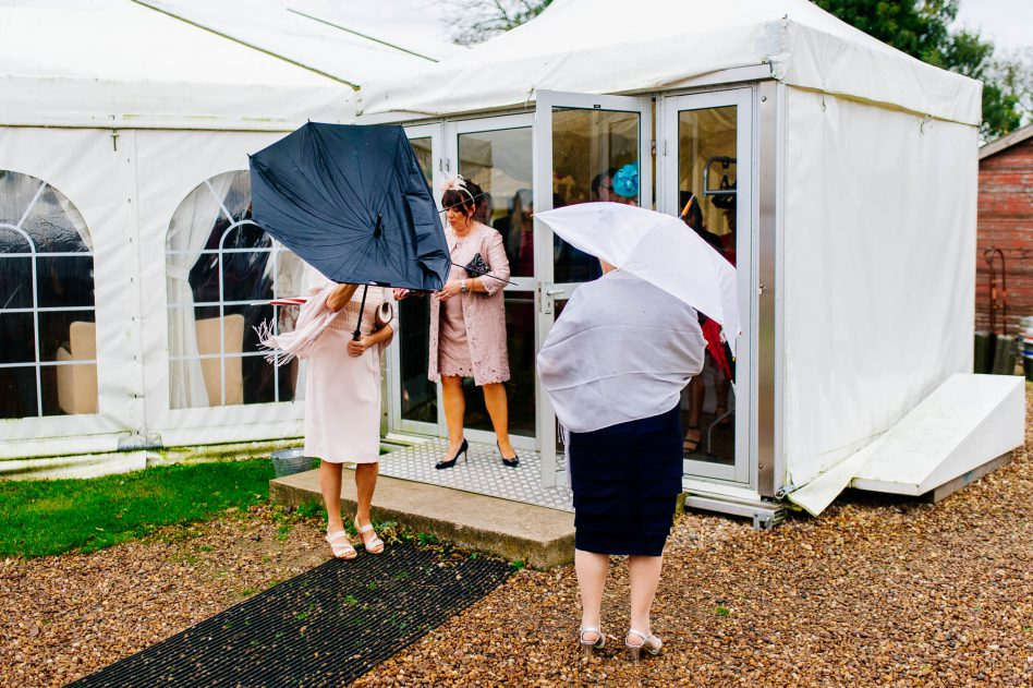 Wedding guests waiting in the rain