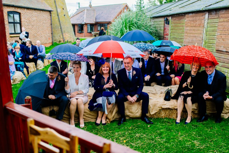 Wedding guests during rain