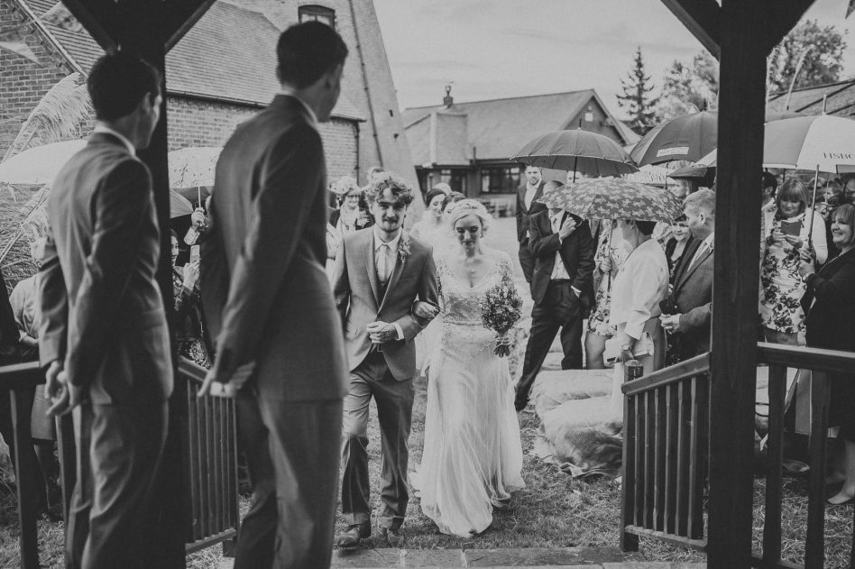 Bride walking down aisle with her brother