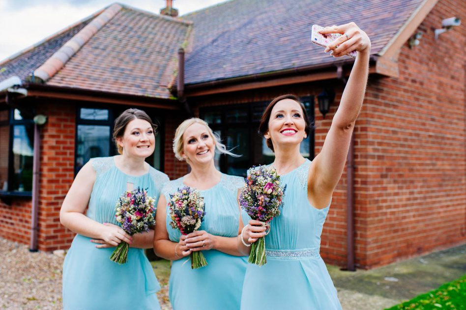 Bridesmaids taking a selfie