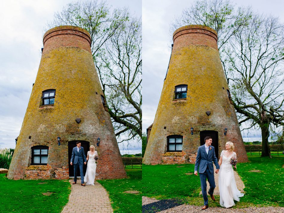Newlyweds walking away from the mill at Fishlake Mill wedding venue