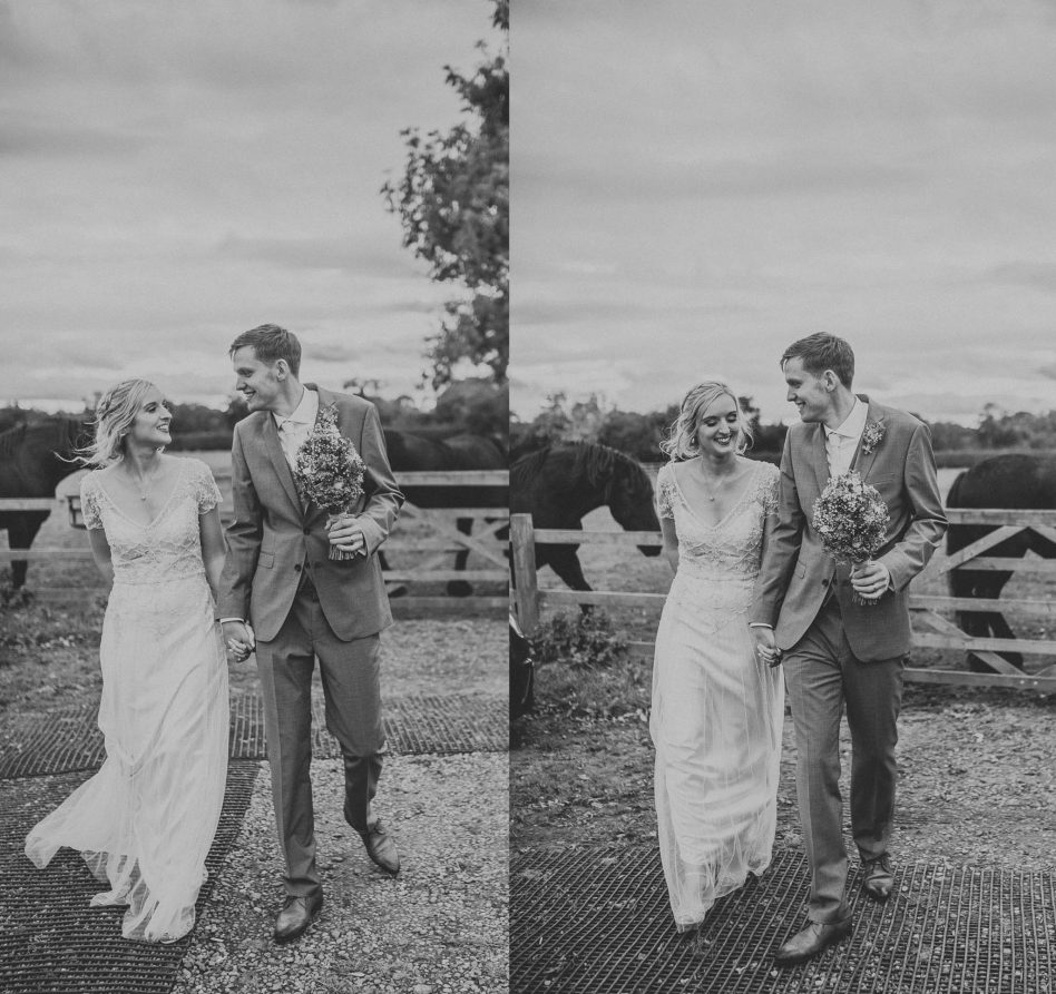Black and white photograph of bride and groom walking at Fishlake Mill