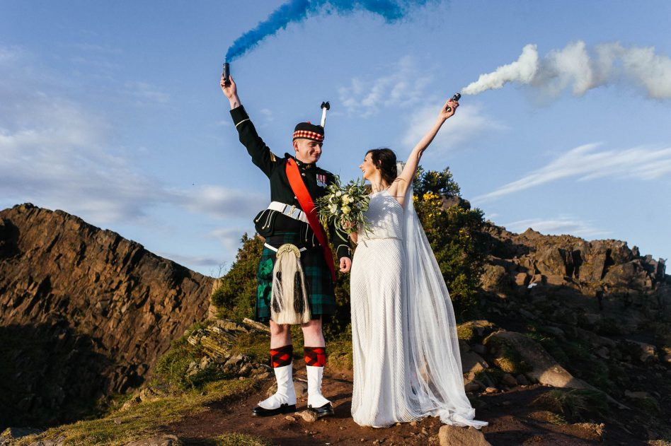 Bride and groom with smoke grenades at Athur's Seat in Edinburgh