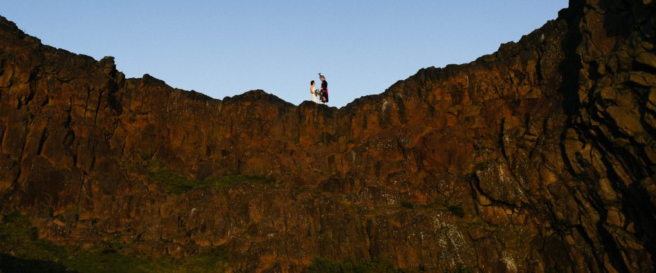 Bride and groom at Arthur's seat in Edinburgh