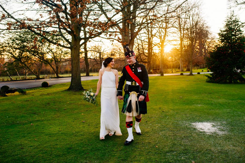 Bride and groom walking in sunshine at Prestonfield House wedding venue