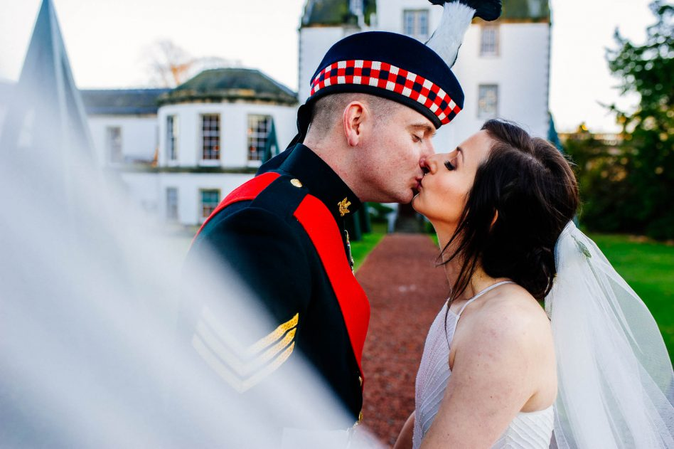 Bride and groom kissing at Prestonfield House wedding venue