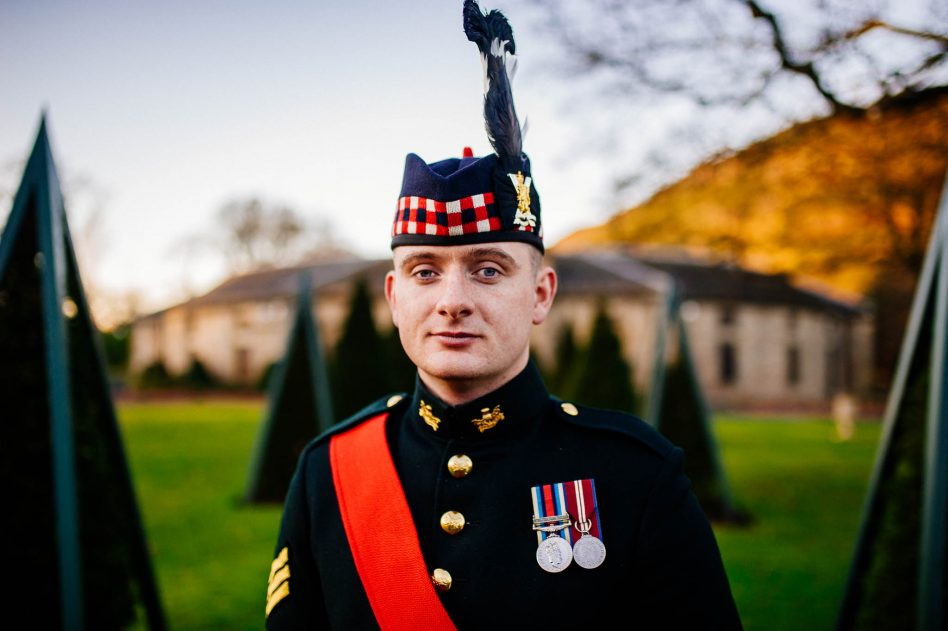 Groom outside the stables at prestonfield house wedding venue