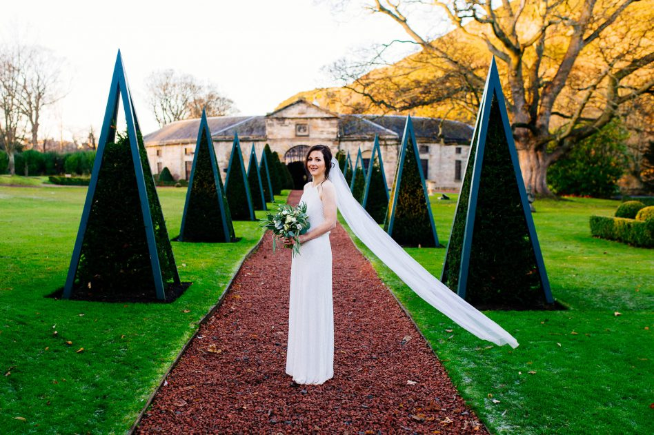 Bride outside the stables at prestonfield house wedding venue