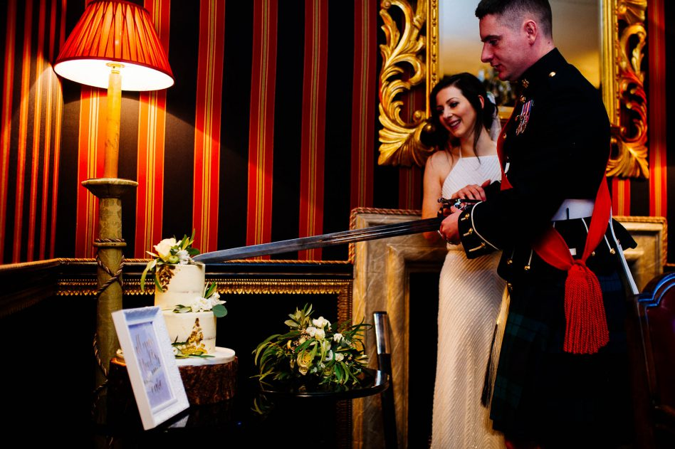 Bride and groom cutting cake at Alnwick Garden wedding venue in Edinburgh
