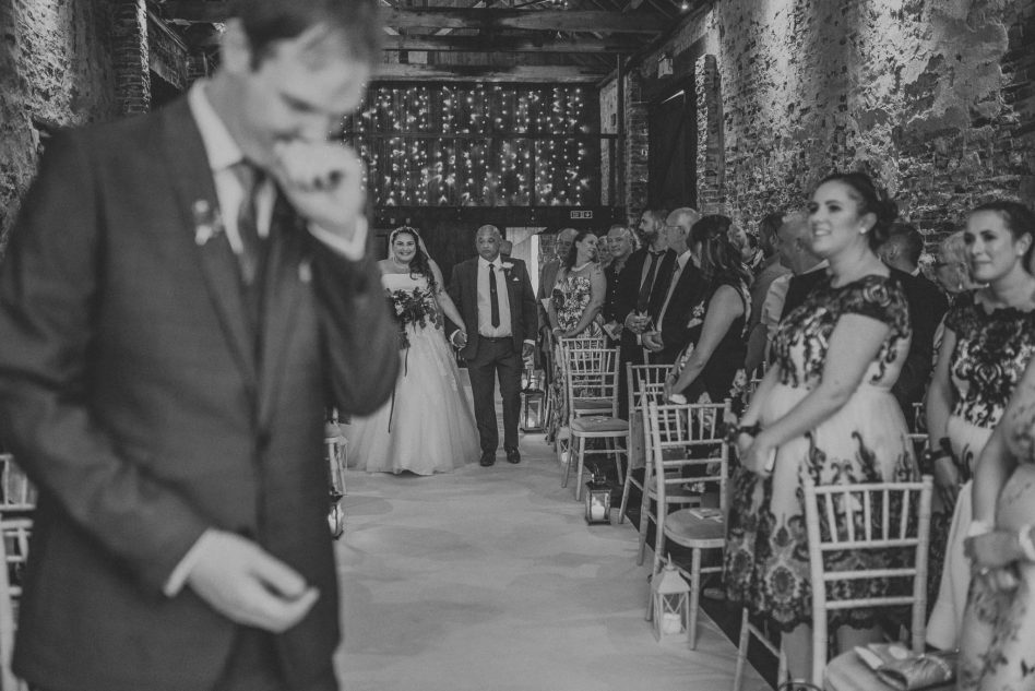Bride walking down the aisle at The Normans in York