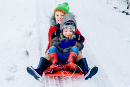 Krystian and Harrison sledging in Peak Distict