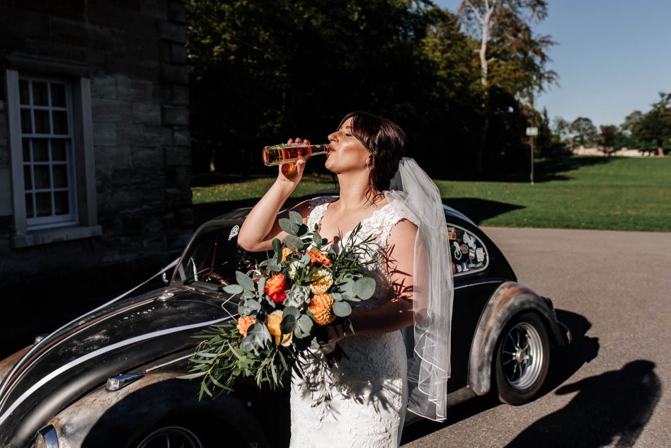 Bride drinking beer before ceremony