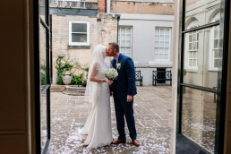 Bride and groom in Priory Place's courtyard