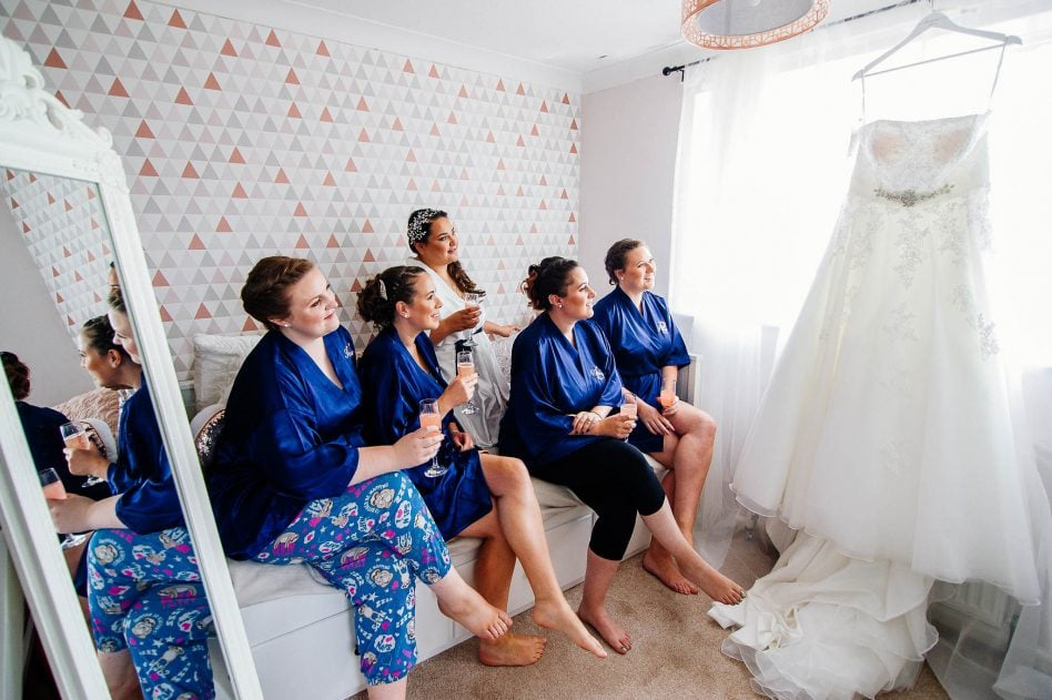 Bride with bridesmaids getting ready
