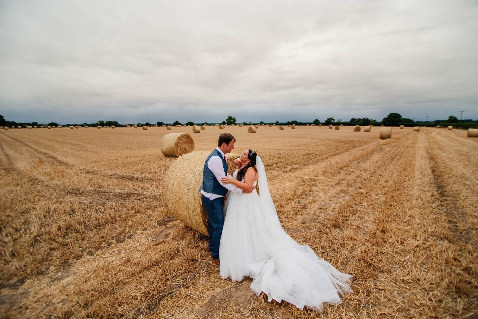 Wedding photography in hay field