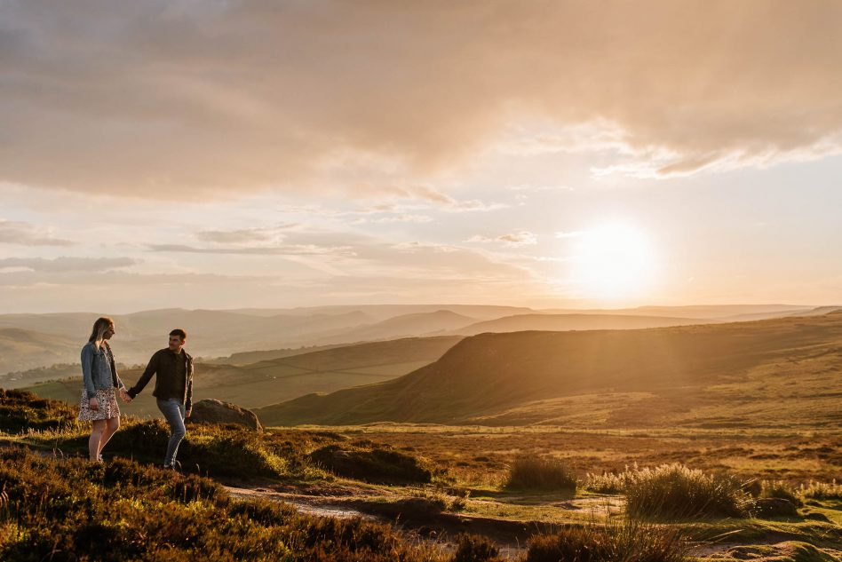 Couple walking in Peak District during an engagement photo shoot