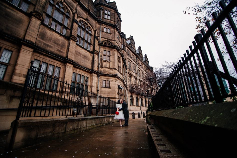 Bride and groom posing outside Sheffield Town Hall wedding venue