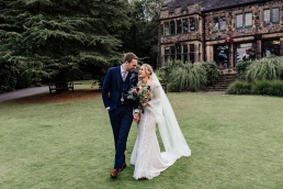 Bride and groom outside Whirlowbrook Hall wedding venue in Sheffield