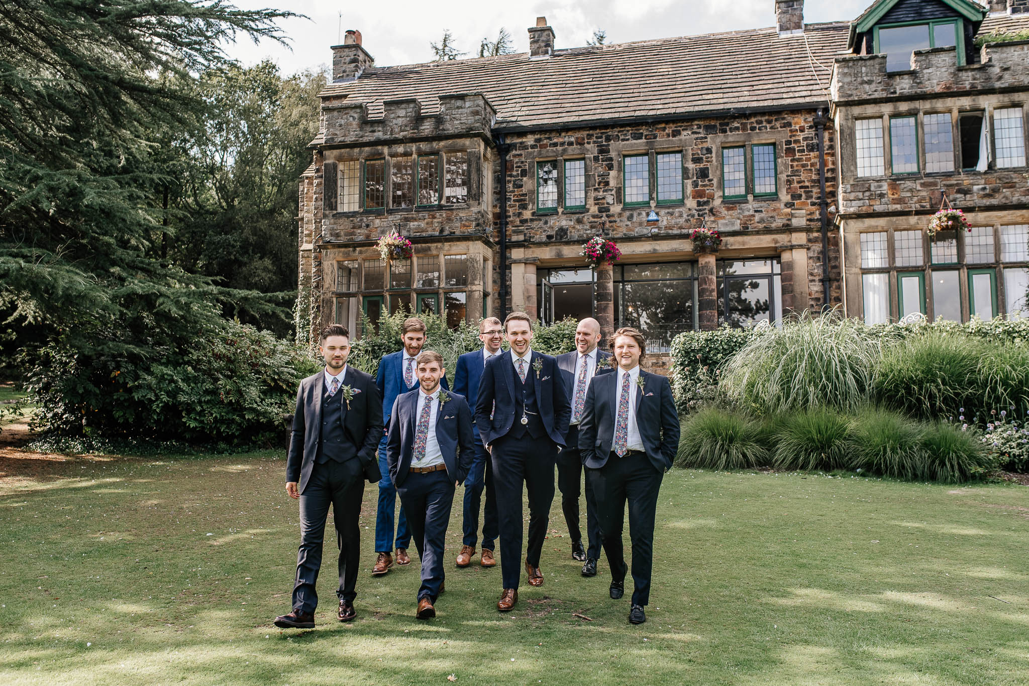 Groom with groomsmen outside Whirlowbrook Hall in Sheffield
