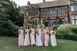 Bride with bridesmaids outside Whirlowbrook hall wedding venue